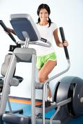 Image of beautiful girl on training apparatus in sport club Stock Photos
