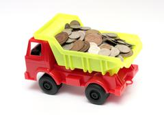 Toy lorry with coins - business concept Stock Photos