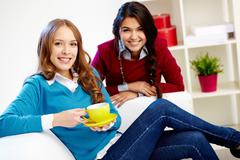 portrait of young females looking at camera at home - stock photo