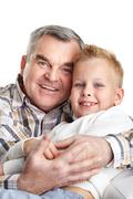 Stock Photo of portrait of happy grandfather embracing cute grandson