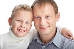 Portrait of happy father and son looking at camera Stock Photos