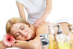 portrait of calm female having rest during procedure of massage - stock photo