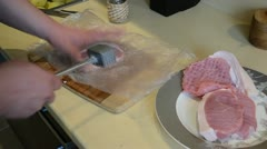 Meat piece beat with metal hammer cloak with polyethylene film Stock Footage