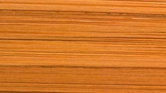 Close up of a bamboo ply cutting board Stock Footage