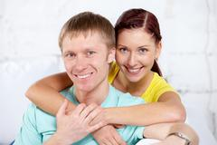 Portrait of happy couple looking at camera Stock Photos