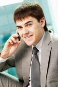 portrait of handsome man calling by mobile phone - stock photo