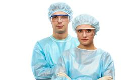 portrait of two surgeons, a man and a woman isolated on white - stock photo