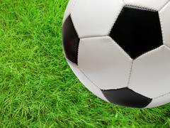 Football soccer ball over green grass Stock Photos