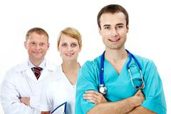 portrait of friendly doctors looking at camera with smiles - stock photo