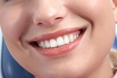close-up of happy female showing her healthy teeth in smile - stock photo