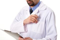close-up of physician taking pen from pocket - stock photo