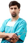 Stock Photo of portrait of confident doctor with stethoscope in hand looking at camera