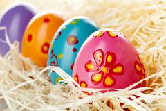 Row of colored and decorated easter eggs Stock Photos