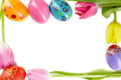 Frame made up of tulips and easter eggs Stock Photos