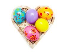 Heart shaped box full of colorful easter eggs Stock Photos