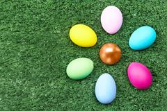 Stock Photo of close-up of colorful easter eggs on green grass