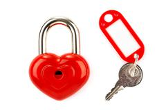 Red lock and key isolated on a white background Stock Photos