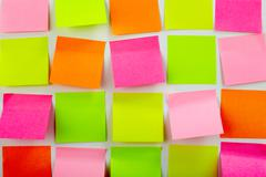 Image of colorful note papers stuck in several rows Stock Photos