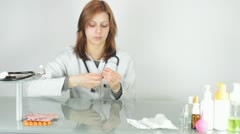 Doctor prepares a syringe for injection Stock Footage
