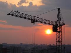 lifting crane and sunset - stock photo