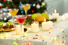 Stock Photo of image of holiday objects: cocktails, burning candles and christmas decorations