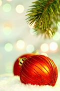 red christmas bauble against glaring background - stock photo