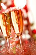 two champagne flutes on christmas background - stock photo