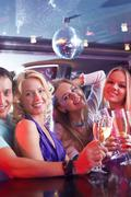 portrait of boozing people in smart clothing toasting at party - stock photo