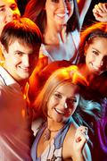 Image of attractive young people having fun at disco Stock Photos