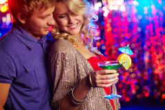 Young couple entertaining together at a party Stock Photos