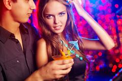 Image of pretty girl with her boyfriend in the night club Stock Photos