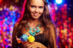 Image of happy girl with cocktail in the night club Stock Photos