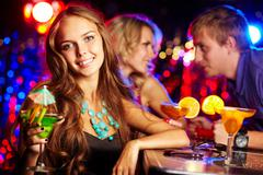 Image of gorgeous girl with cocktail looking at camera Stock Photos