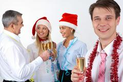 Portrait of happy businessman with champagne on background of partners Stock Photos