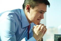 Image of serious man concentrating on thoughts Stock Photos