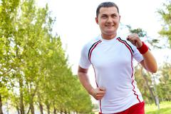image of sportsman running on summer day - stock photo