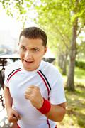 Image of young sportsman running outdoor Stock Photos