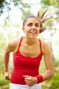 image of happy young female running outdoor - stock photo