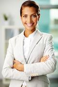 portrait of successful businesswoman looking at camera with smile - stock photo