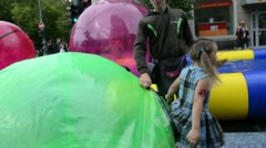 Girl get out from zorb bubble ball in vilnius gediminas prospect Stock Footage