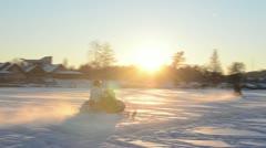 People drive snowmobile transport Galves lake Trakai winter Stock Footage