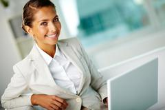 Portrait of successful female working in office Stock Photos