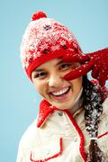 Face of pretty woman in gloves and knitted winter cap looking at camera with two Stock Photos