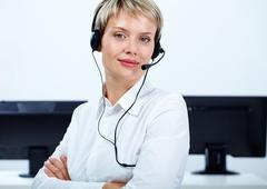 portrait of customer service operator looking at camera - stock photo