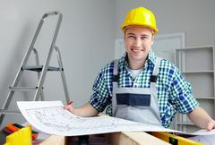 portrait of a smiling architect holding finished project - stock photo