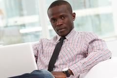 image of young successful businessman sitting in office - stock photo
