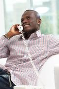 Image of friendly businessman talking by the phone Stock Photos