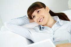 Portrait of glad businesswoman in front of laptop Stock Photos