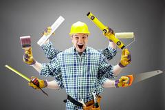 portrait of shouting craftsman with different tools in six hands - stock photo