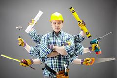 Portrait of serious craftsman with different tools in six hands Stock Photos